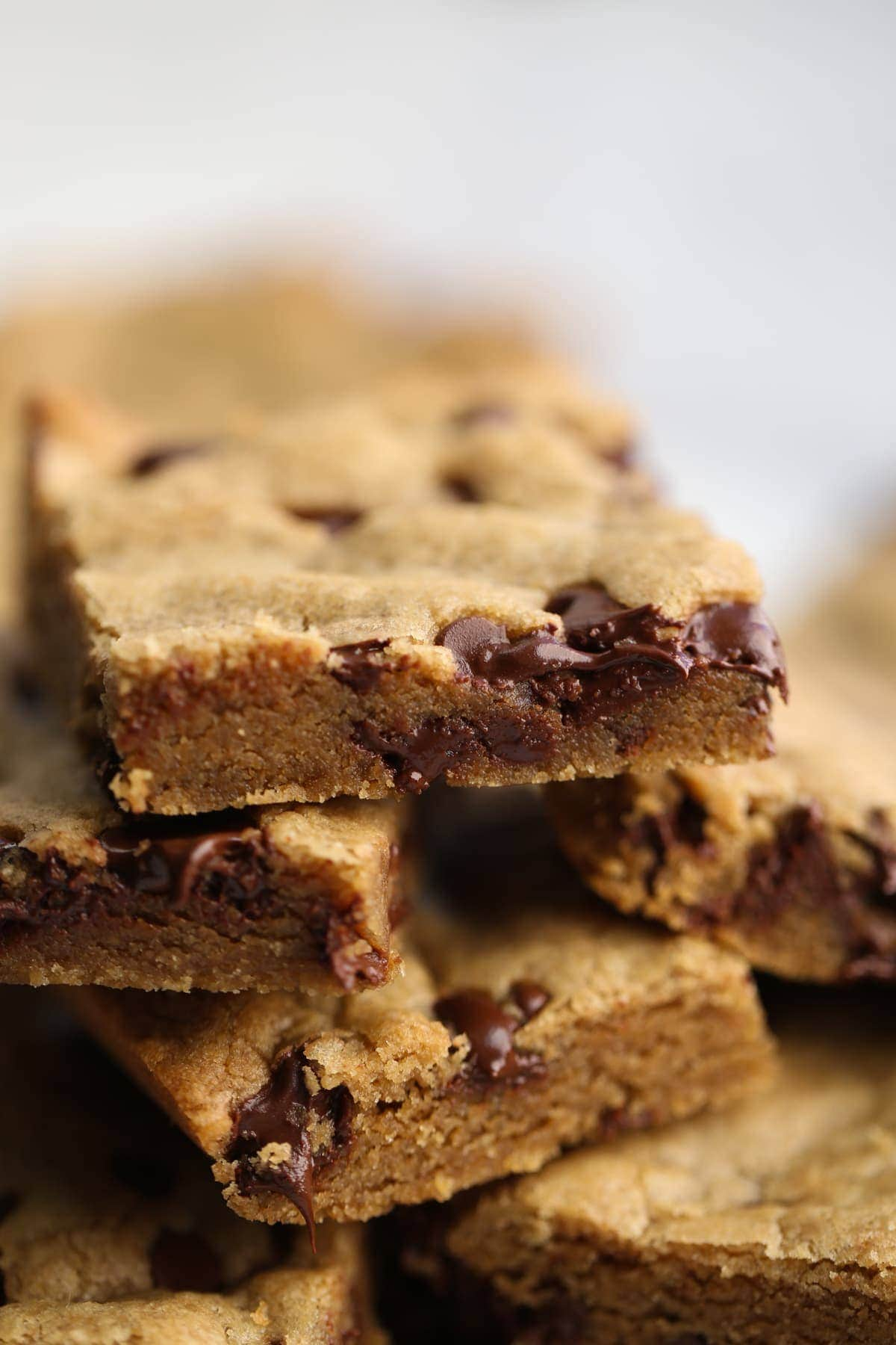 Peanut Butter Chocolate Chip Bars stacked on top of each other