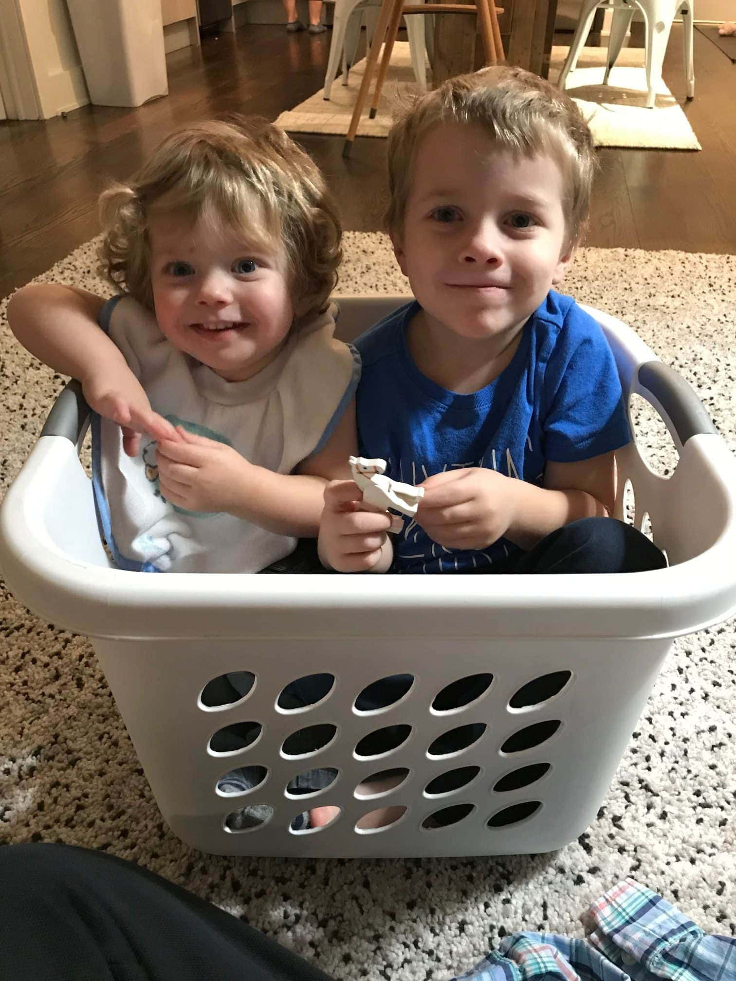 Eddie and Blake in a laundry basket