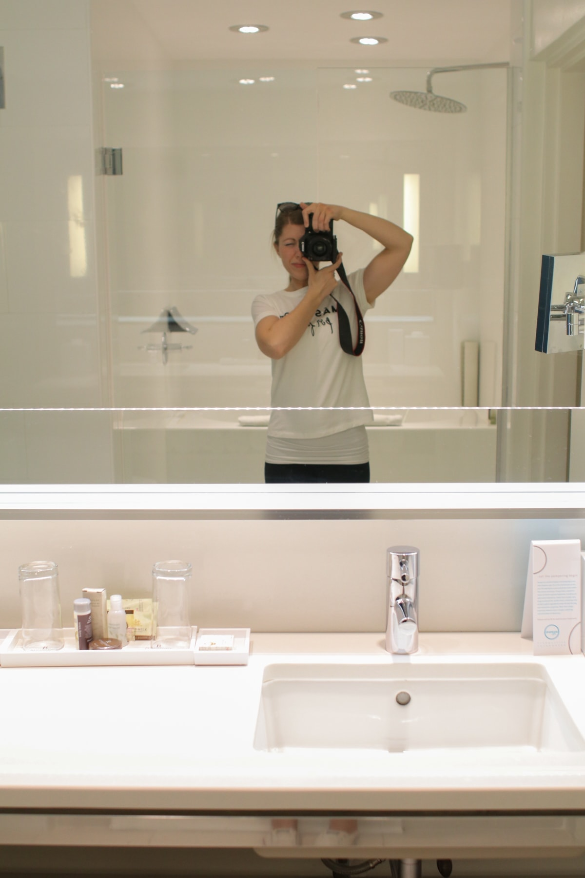 A person in front of a mirror posing for the camera