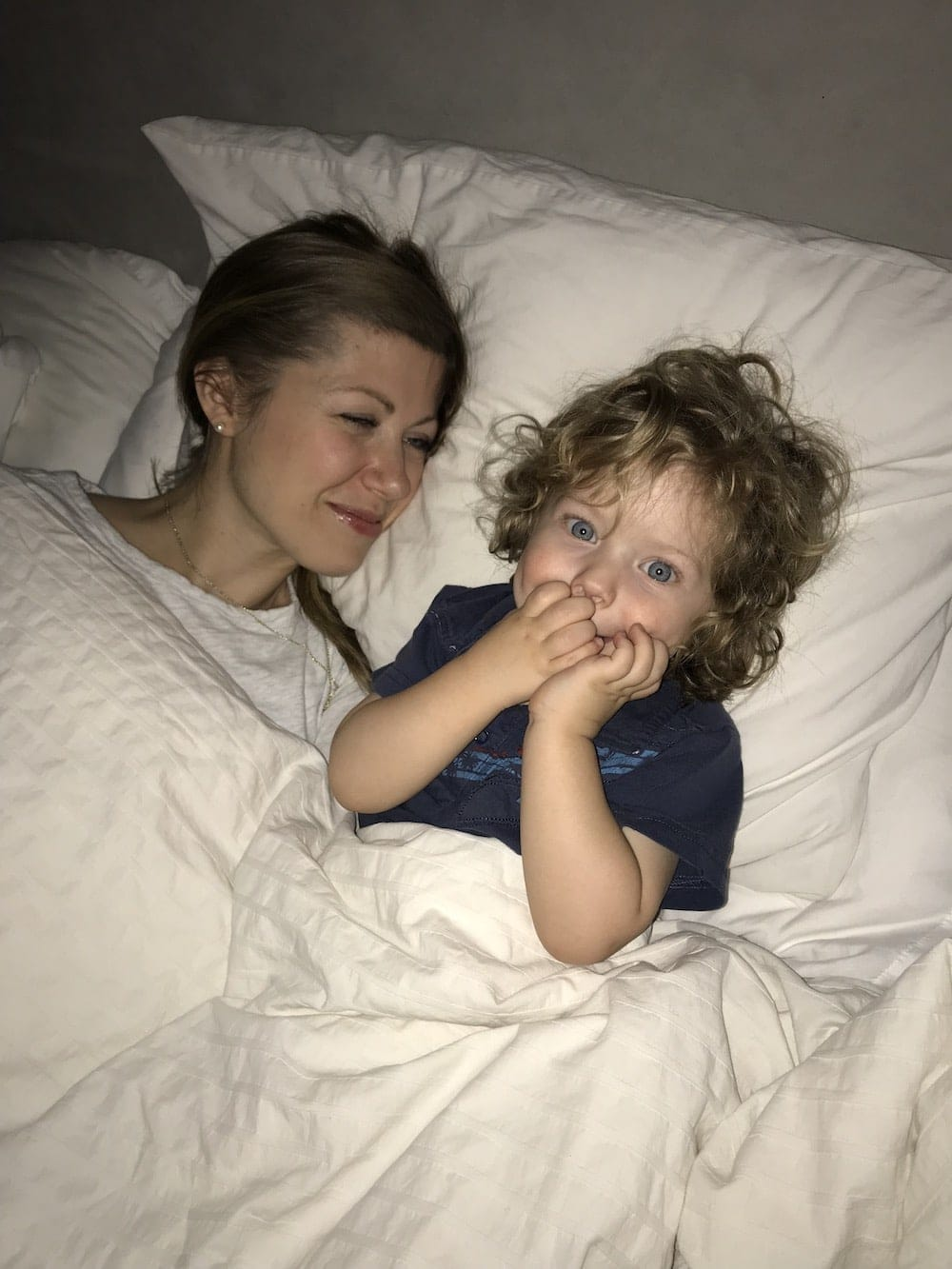 Lauren and Eddie laying in bed