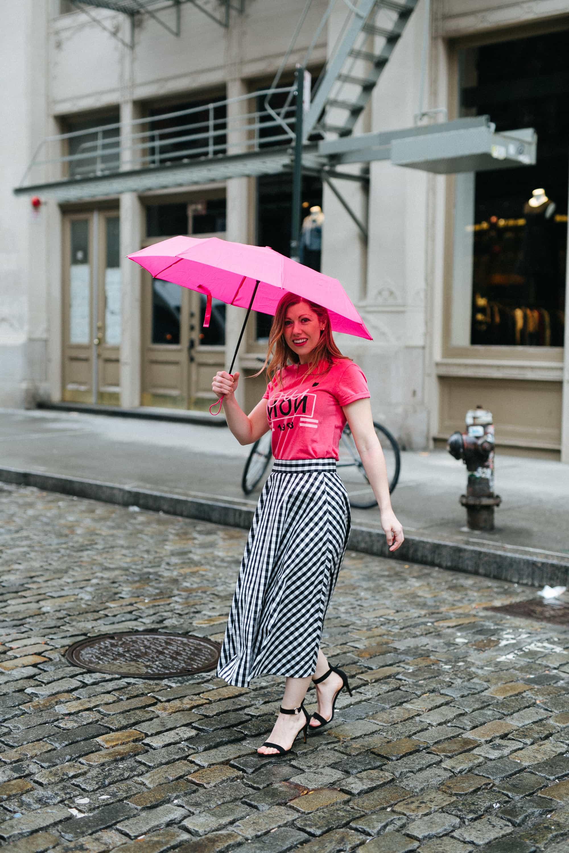 Lauren holding an umbrella