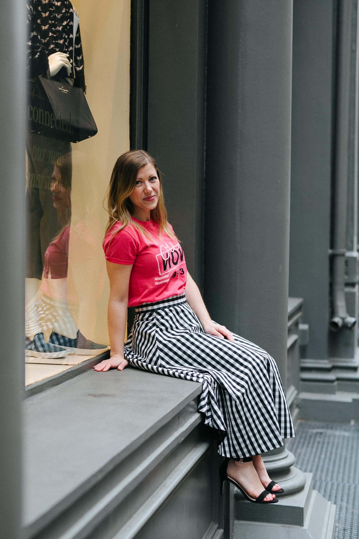 Lauren sitting on a window sill