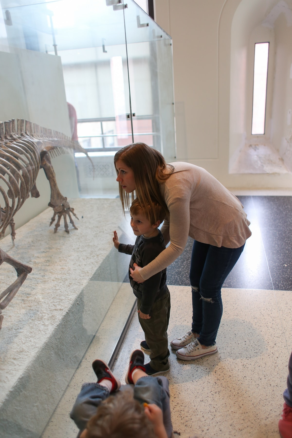 Lauren and Blake looking at a dinosaur skeleton