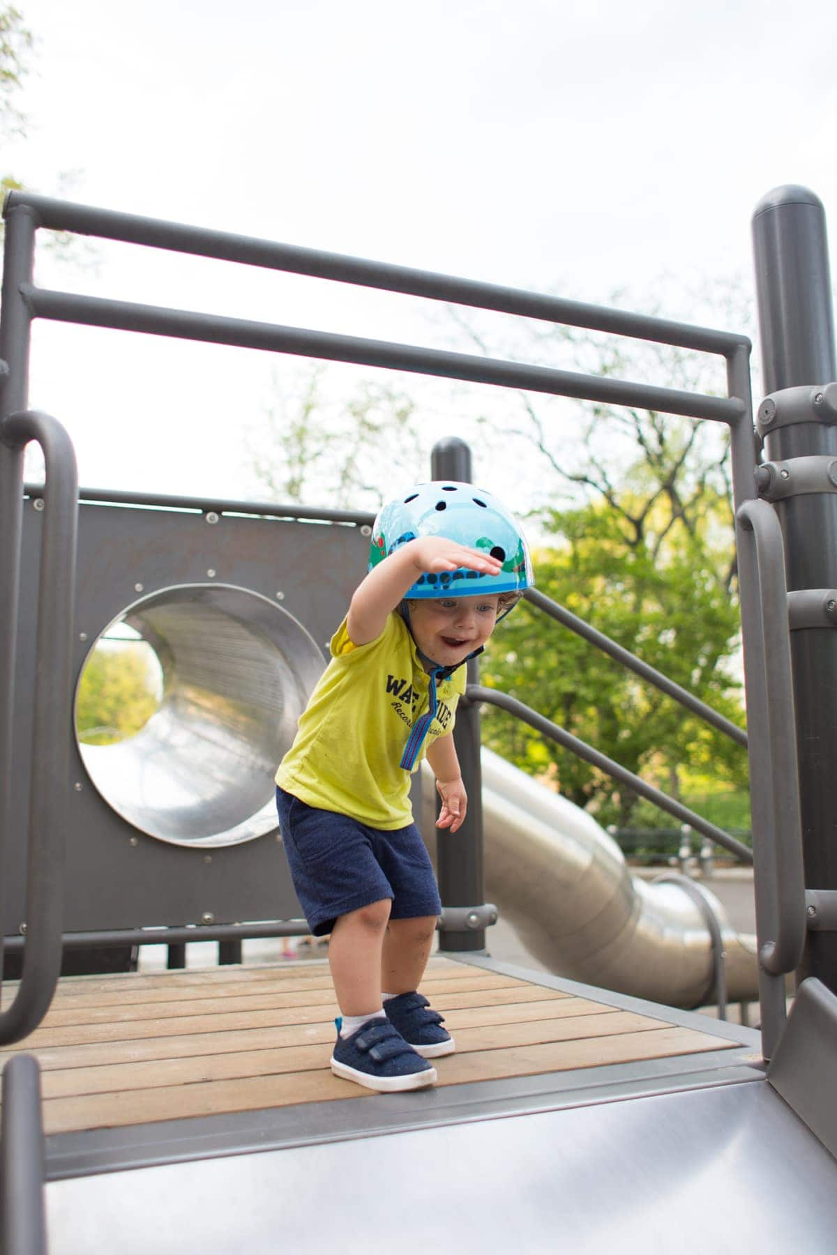 Eddie playing on a play structure