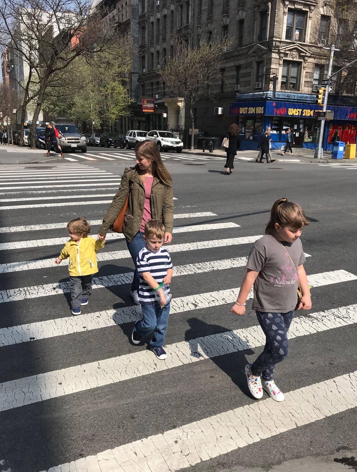 Lauren and the kids walking across the street
