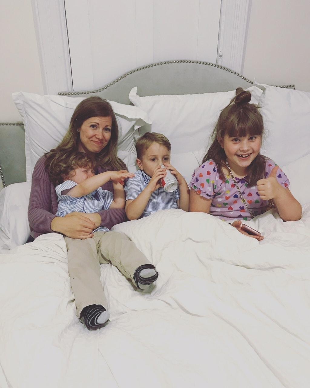 Lauren and the kids in bed