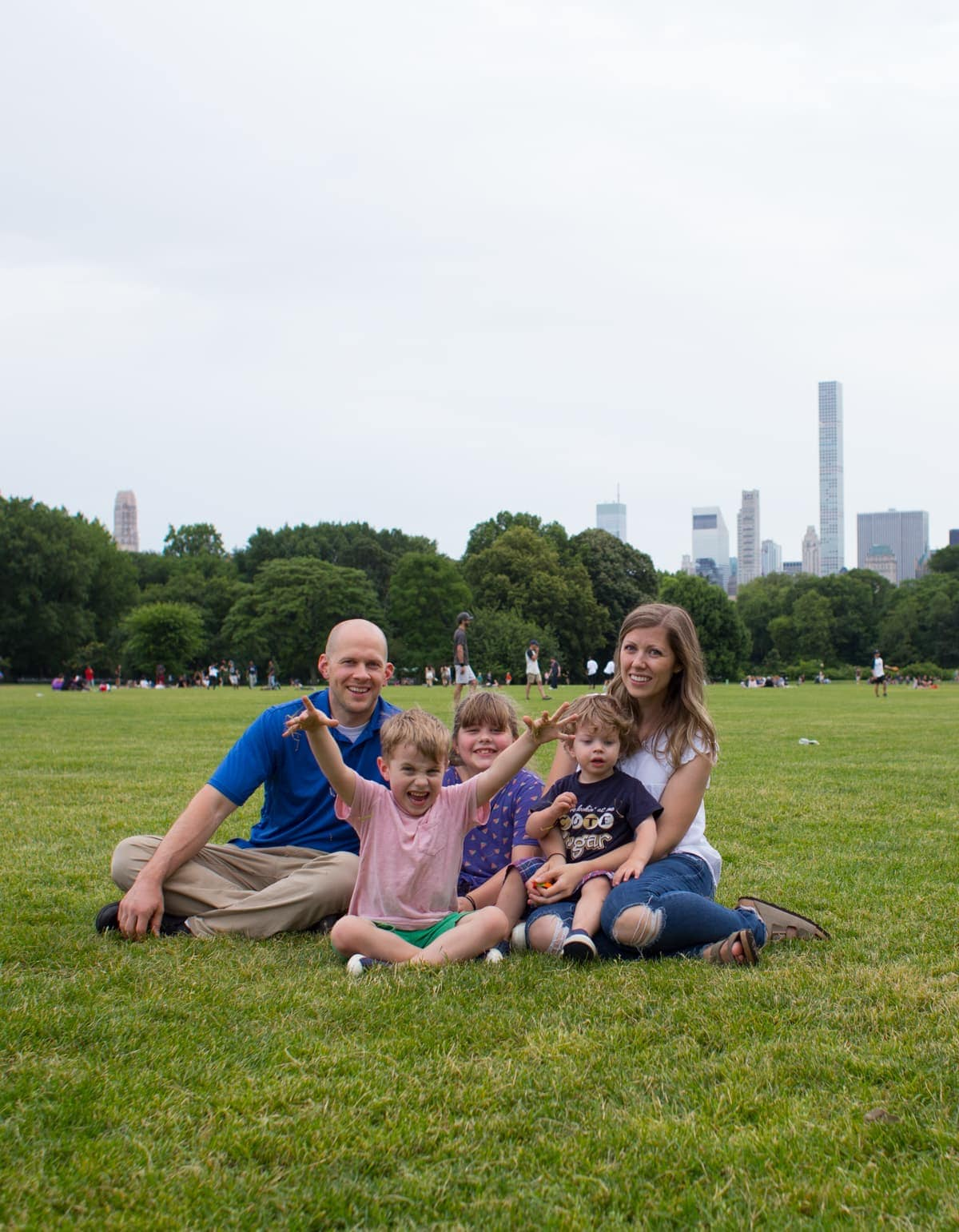 Brennan family sitting in a grassy field