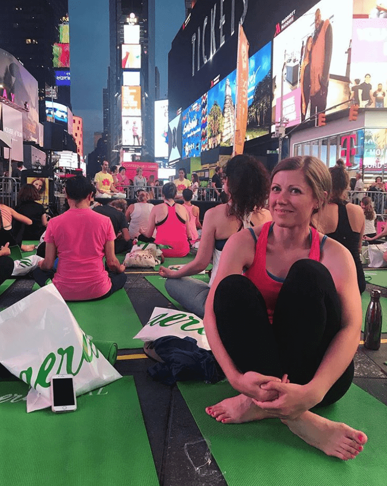 Lauren doing yoga in Times Square