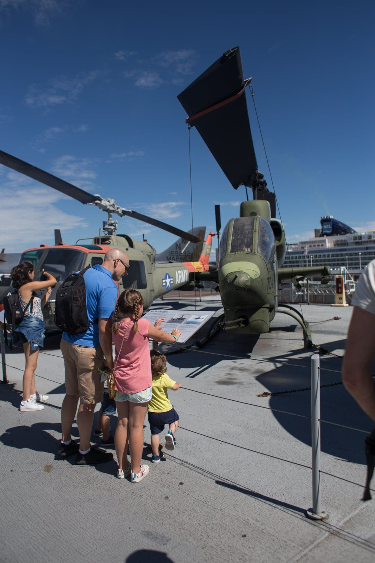 Gordon and the kids in front of a helicopter