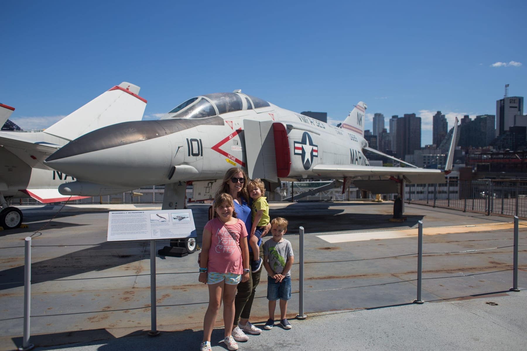 The kids in front of a plane