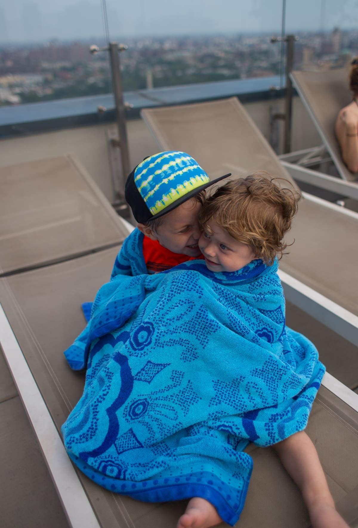 Eddie and Blake wrapped up in a blue towel