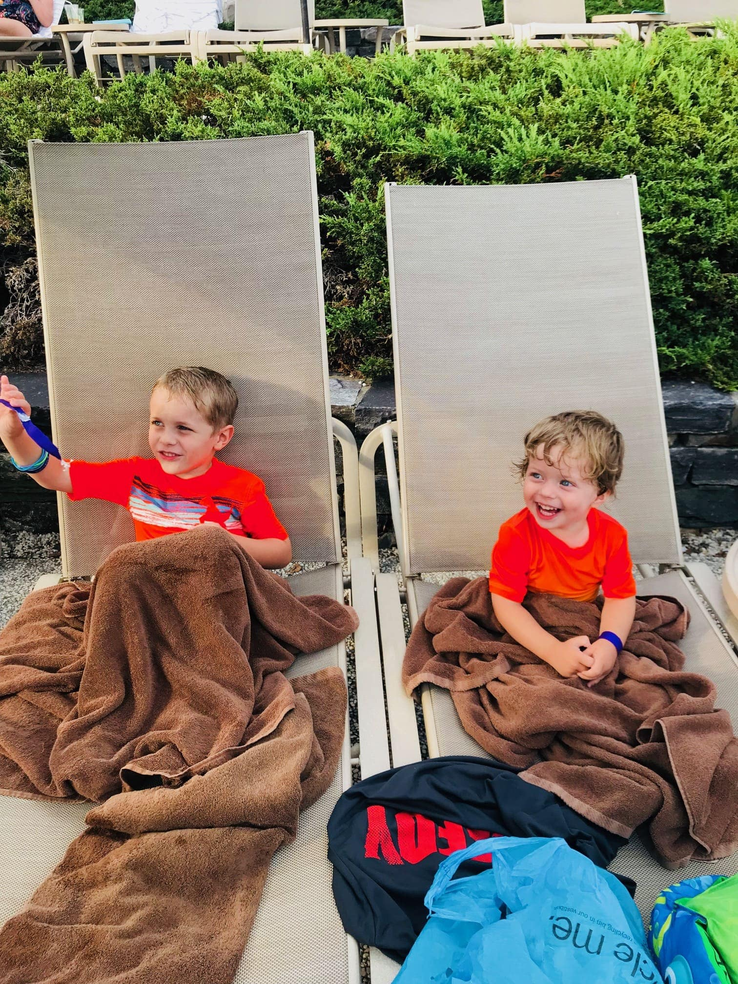 Blake and Eddie in lounge chairs with blankets