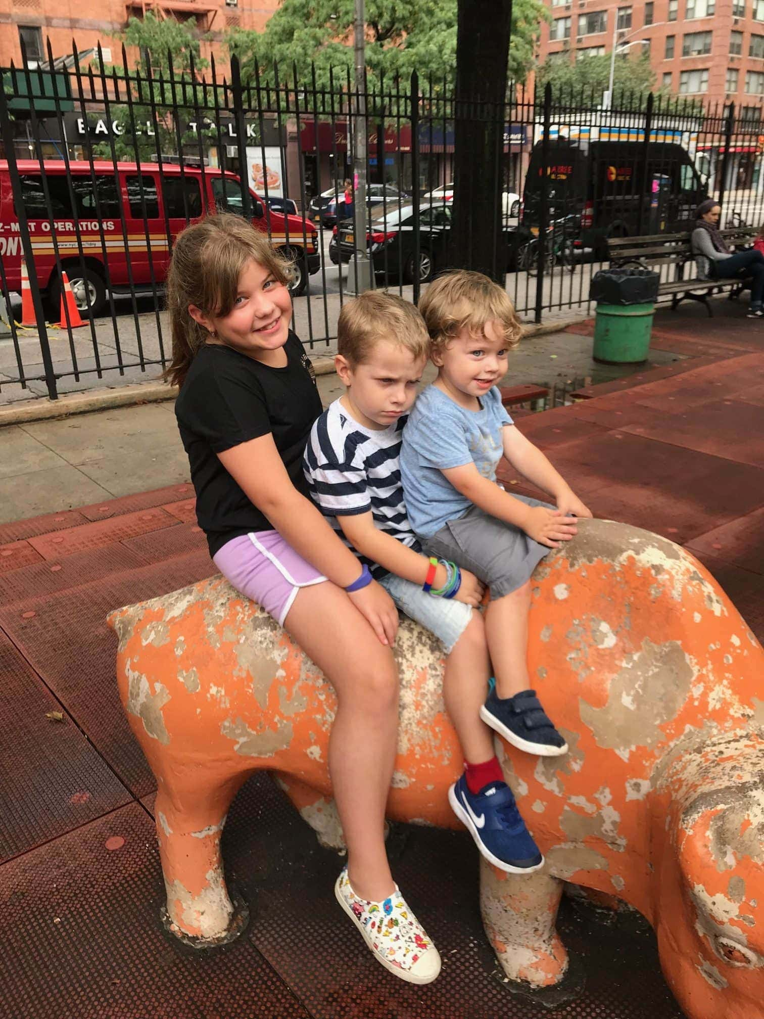 The kids on a statue