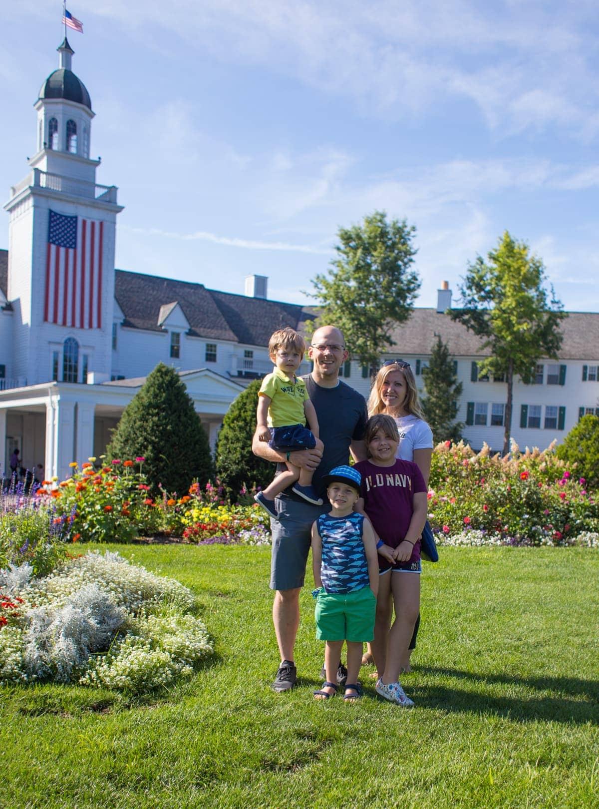 Brennan family standing in a grassy yard