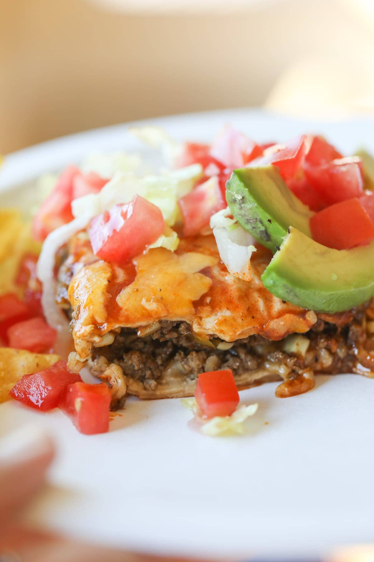 piece of taco casserole with toppings