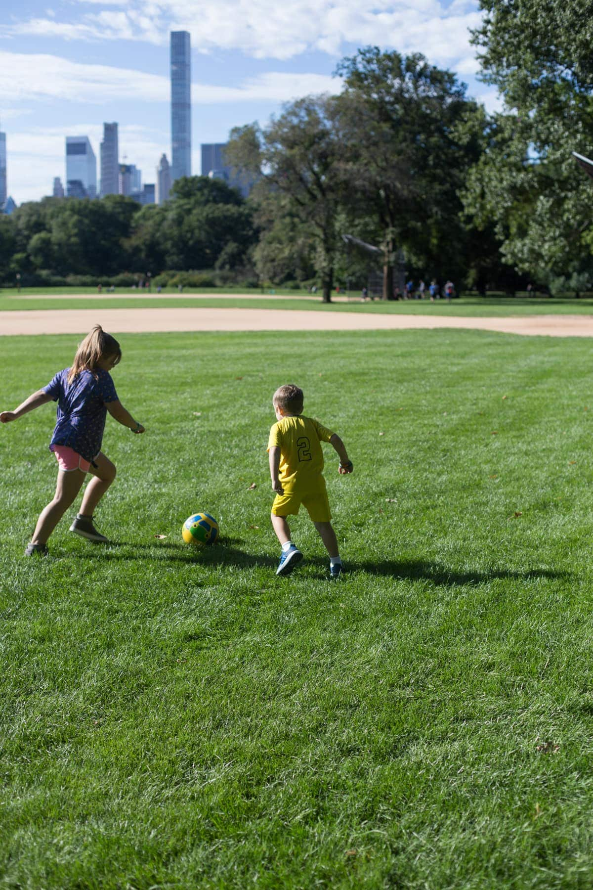 Brooke and Blake playing ball in a field