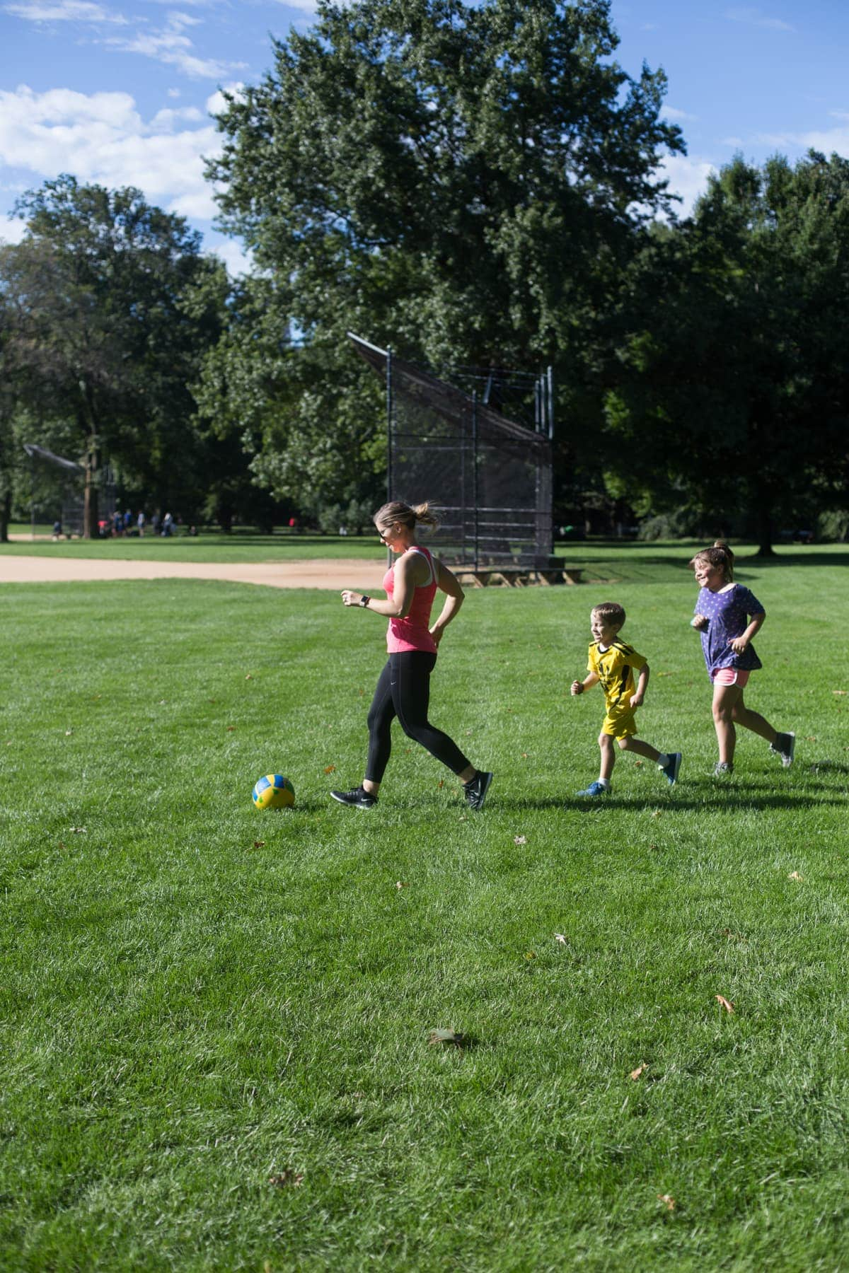 Lauren and the kids playing soccer