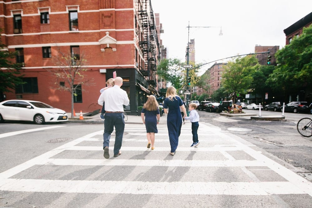Brennan family crossing the street