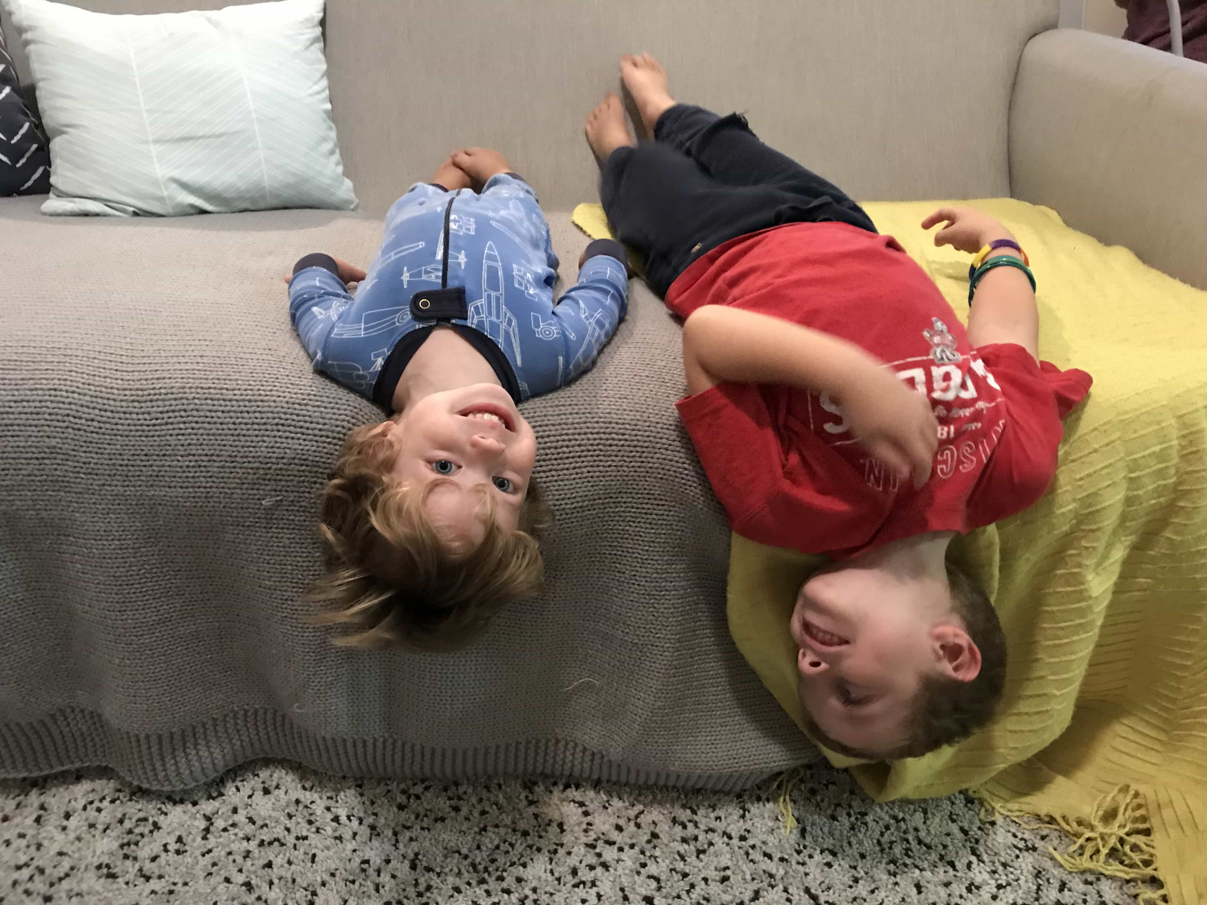 Blake and Eddie upside down on the couch