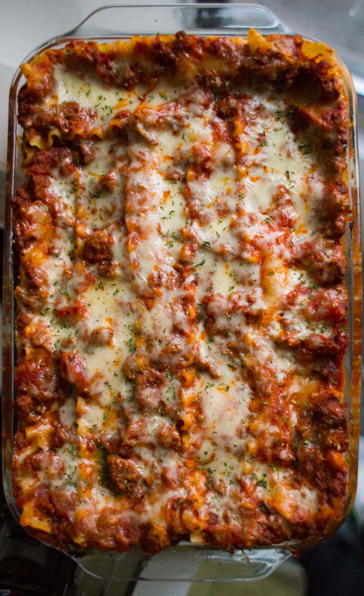 Top down view of lasagna in a glass baking dish