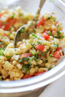 corn salsa in bowl with spoon