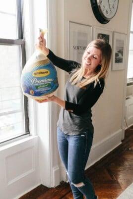 Lauren holding a frozen turkey