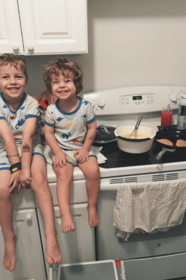 Blake and Eddie sitting on the kitchen counter