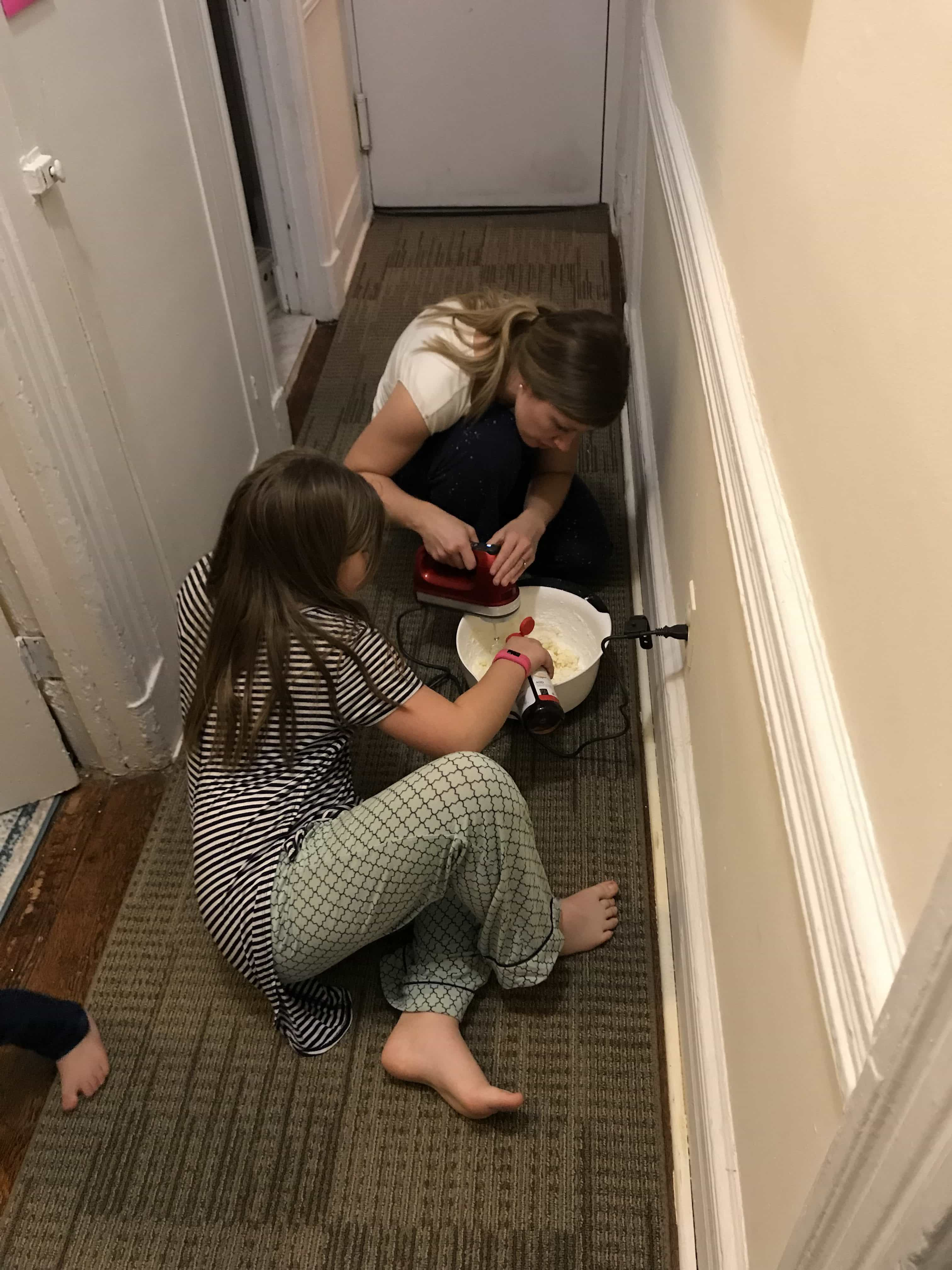 Brooke and Lauren making frosting in the hall