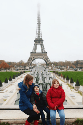 Lauren and the kids in front of the Eiffel Tower
