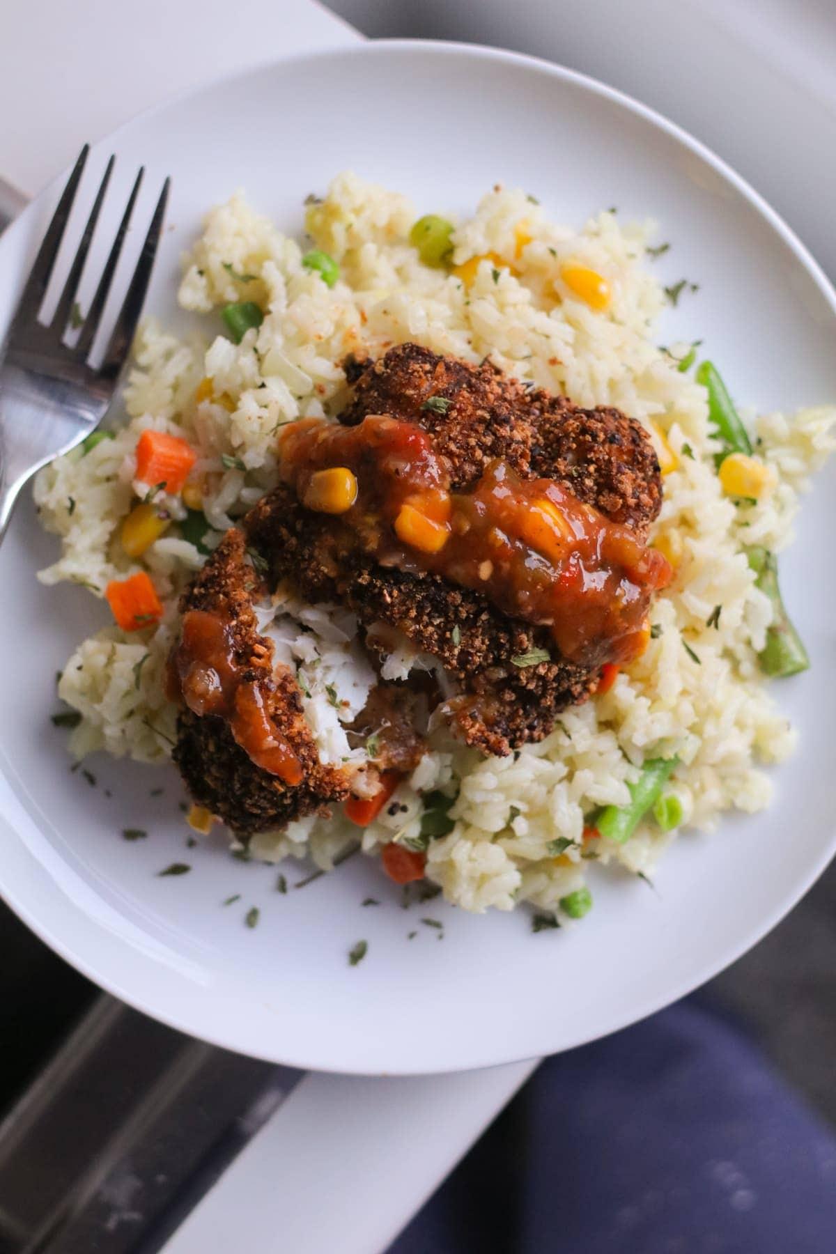 black bean encrusted cod with vegetable rice pilaf
