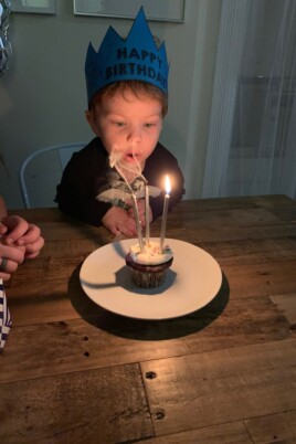 Eddie with a birthday cupcake