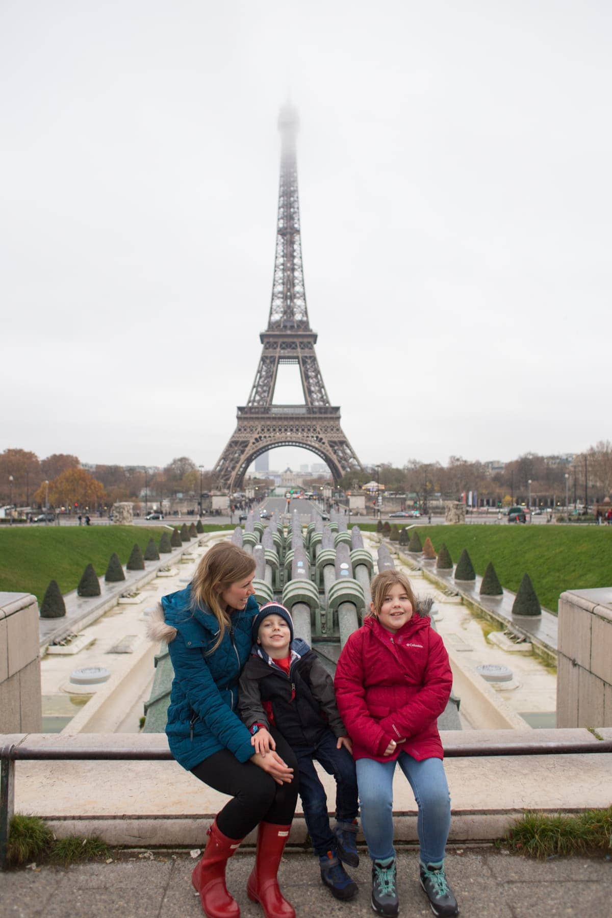 Lauren, Blake and Brooke in front of the Eiffel tower