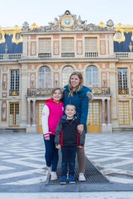Lauren Brooke and Blake in front of the Palace of Versailles