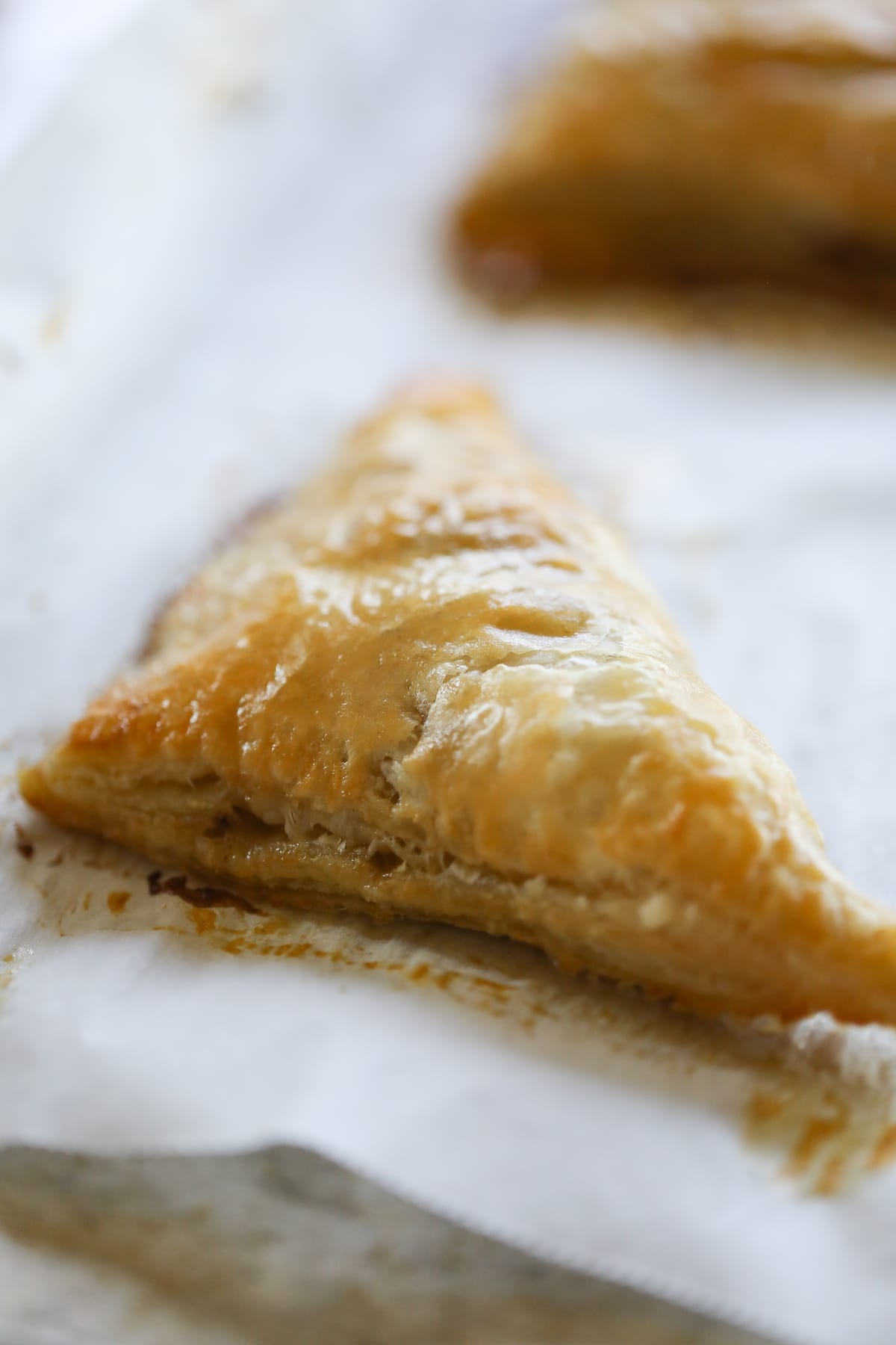 baked apple turnover on parchment paper