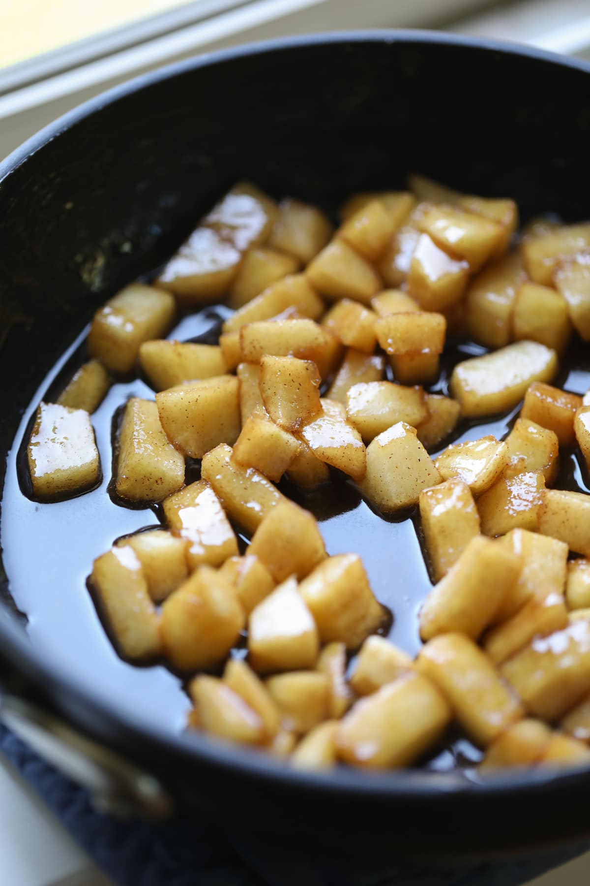 cooked apples in pan