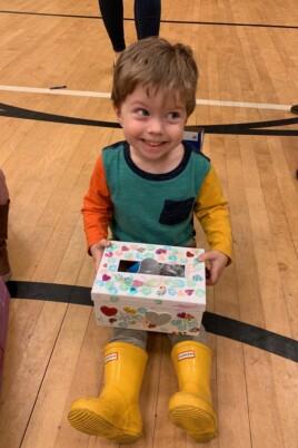 Eddie sitting with a Valentines box