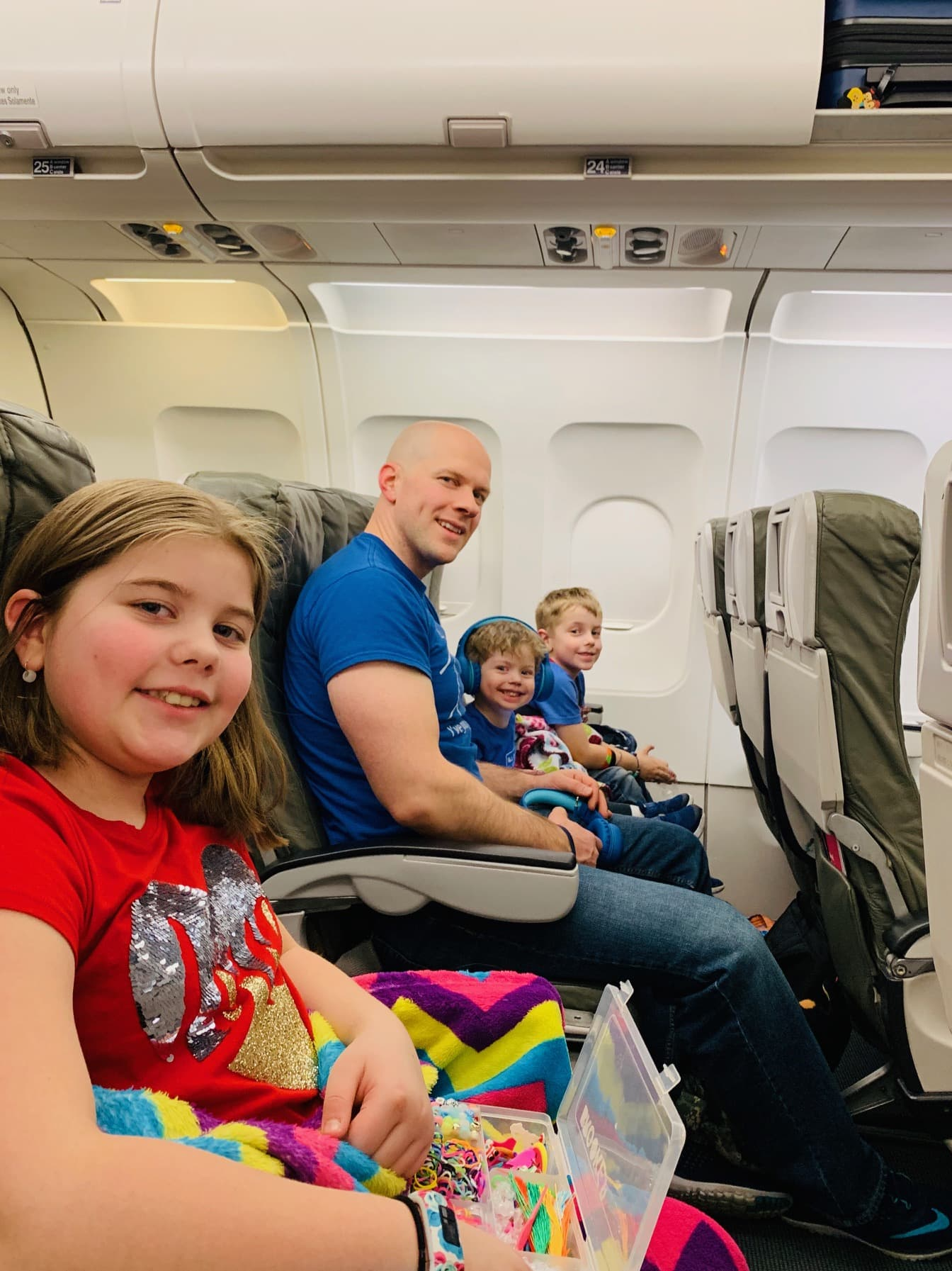 Gordon and the kids on a plane