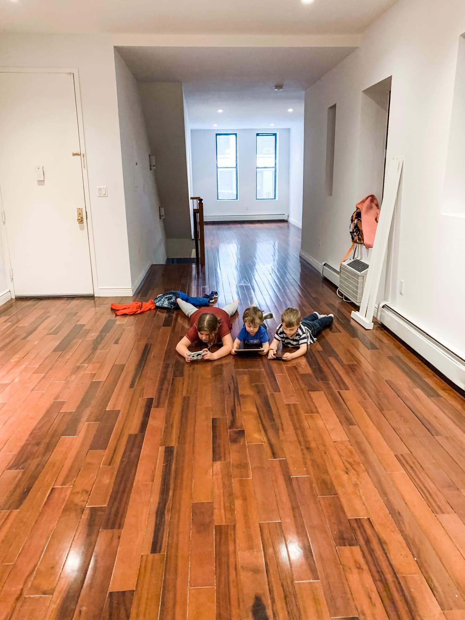 Kids on hardwood ground