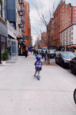 Eddie scooting down the sidewalk