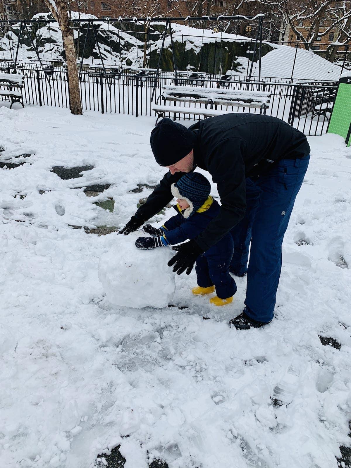 Gordon and Eddie making a snowman