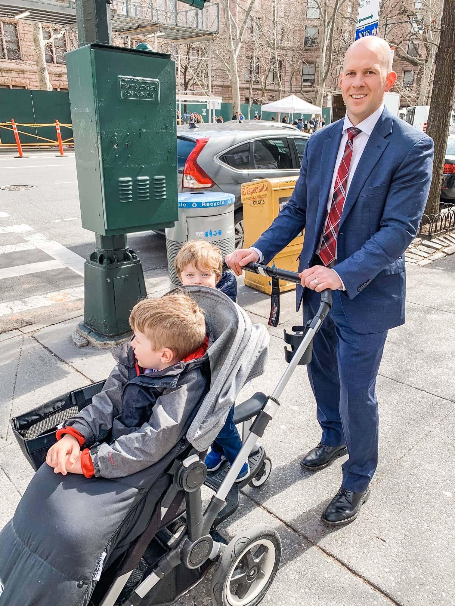 Gordon pushing the stroller with Blake and Eddie