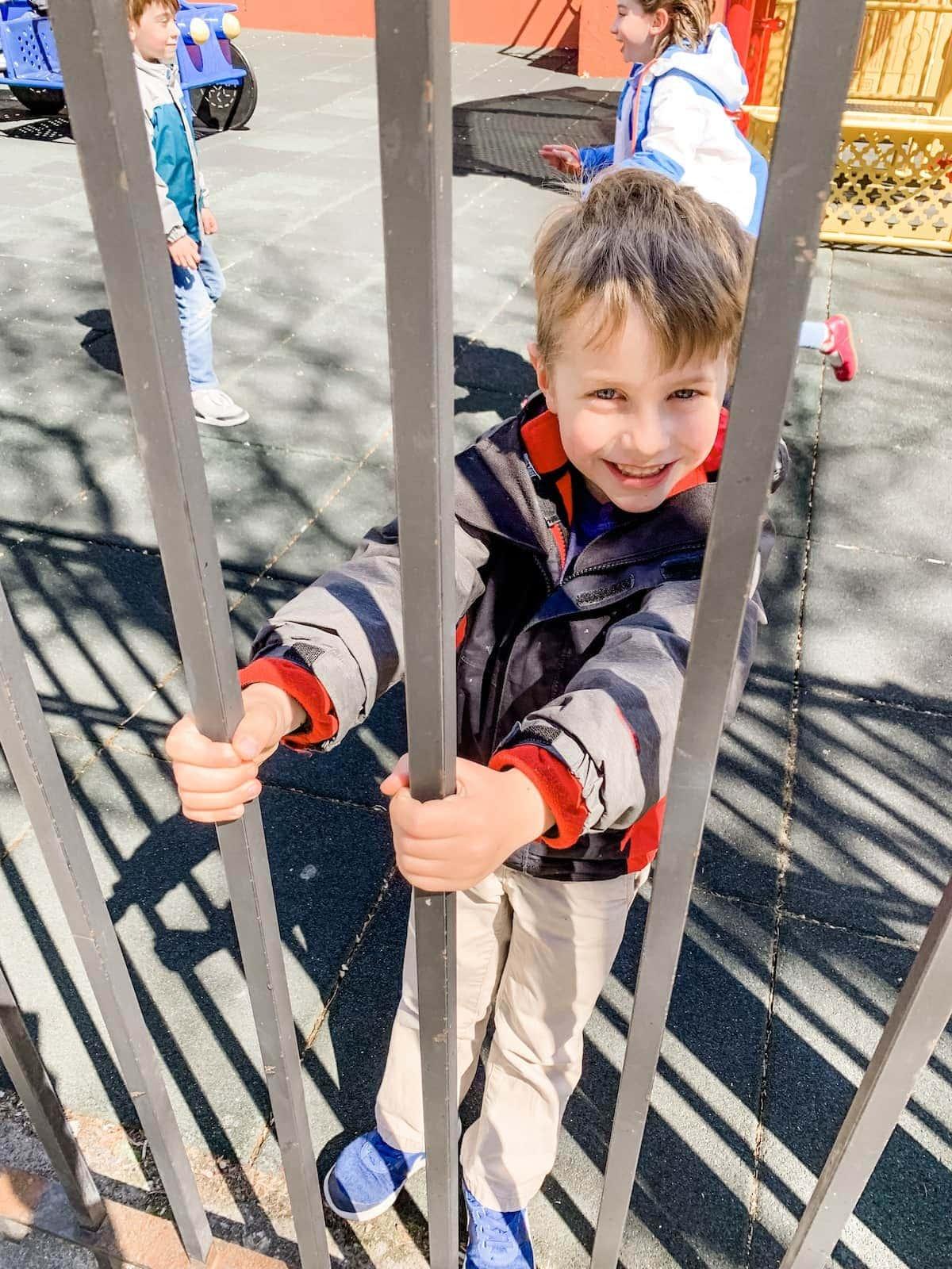 Blake playing on a playground