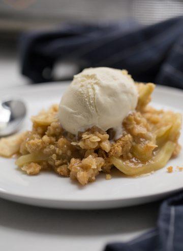 Apple crisp with vanilla ice cream on top