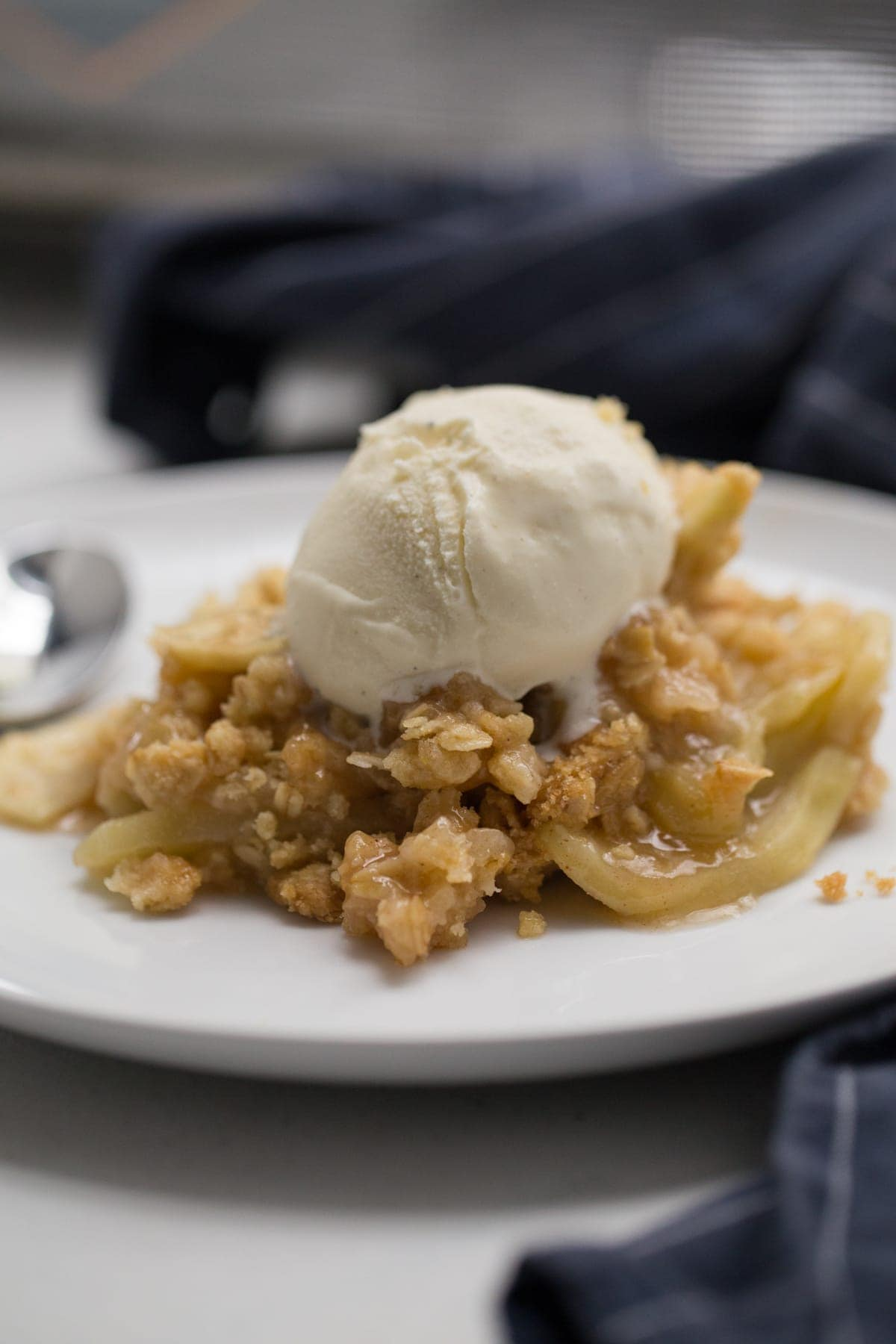 Apple crisp with vanilla ice cream on top