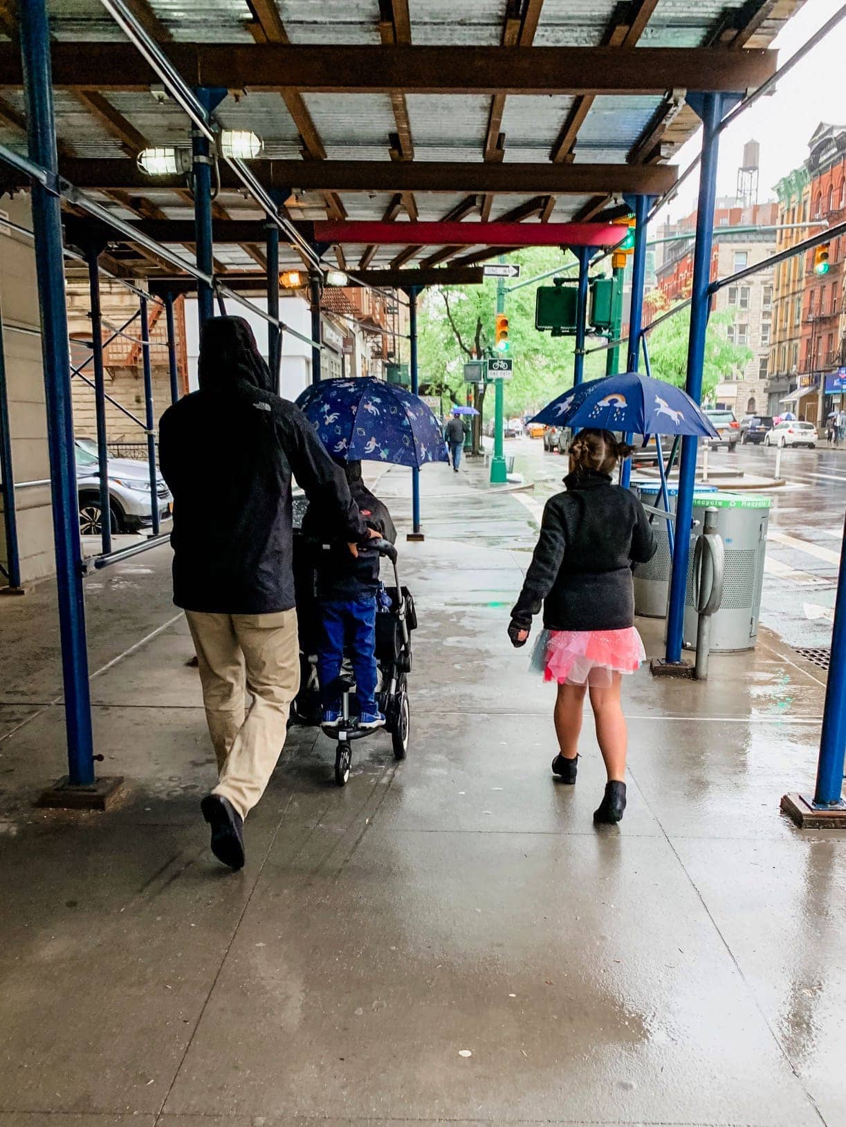 Gordon and the kids walking to church in the rain