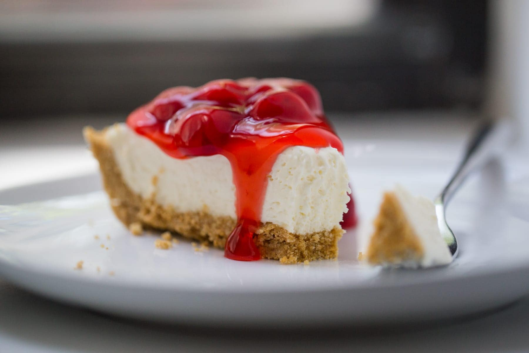 piece of cherry no bake cheesecake