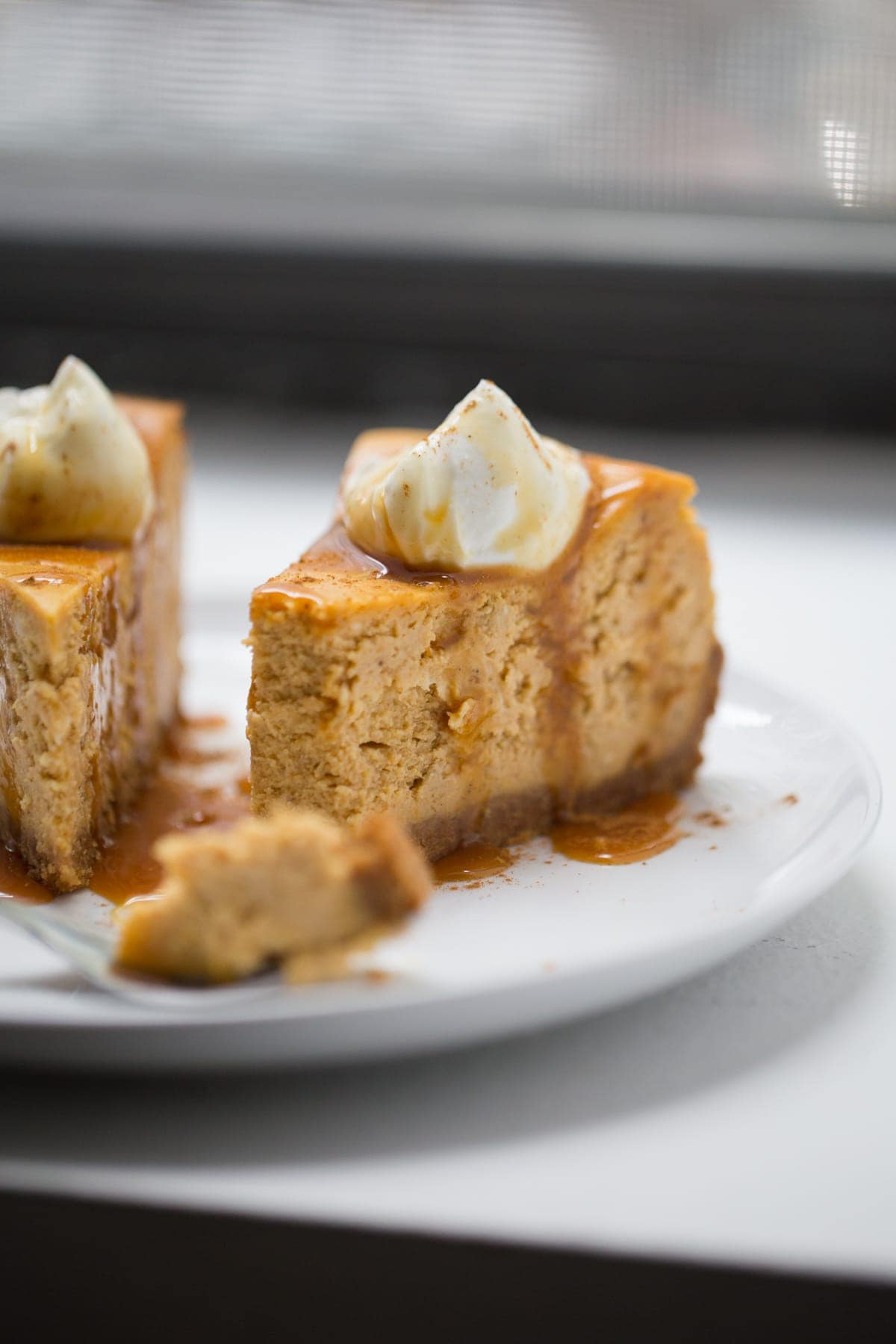 pumpkin cheesecake with piece on fork