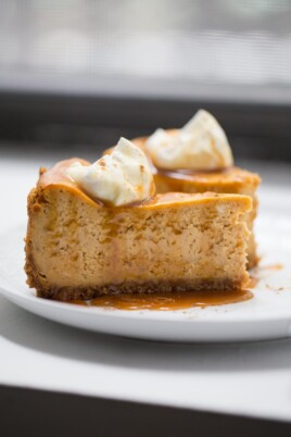 two pieces of pumpkin cheesecake on a white plate