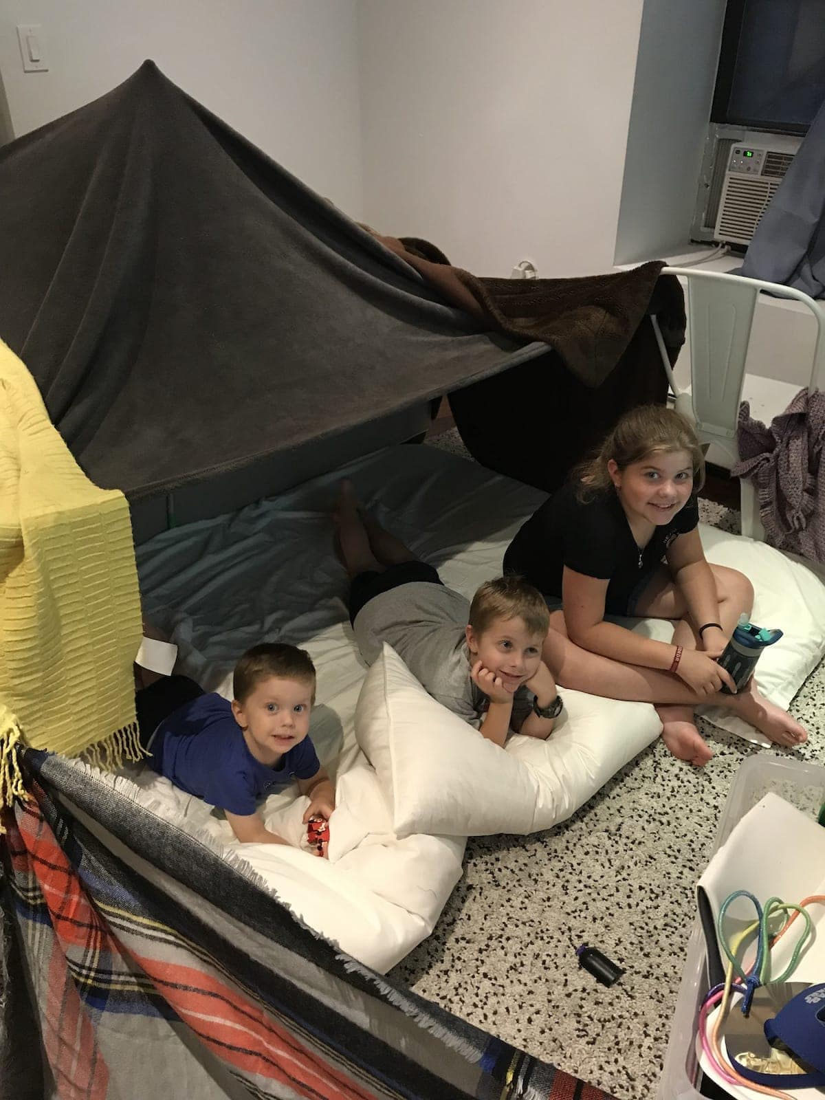 The kids under their blanket fort