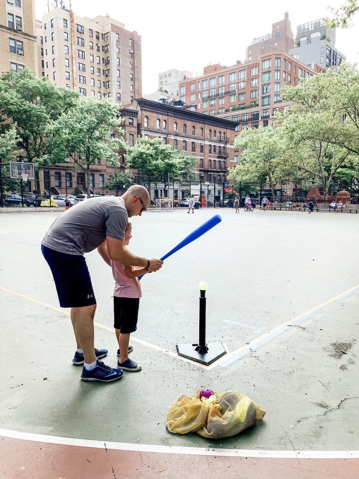 Gordon helping blake with T-ball